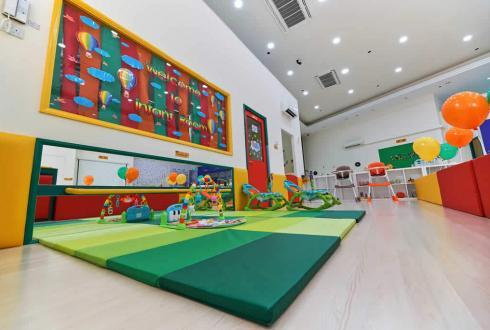 For infants who are learning to crawl or walk, our activity area is equipped with a well-cushioned holding bar, floor mats and mirror. The environment not only aids the infant in his/her next developmental milestone, but also supports the teacher's monitoring of their activities.