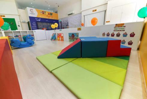 Once the infant is capable of moving around more independently, he/she will seek higher challenges which we cater for in the mobile area. The mobile area is tailored to leverage from the soft climbing blocks to train their gross motor skills.
