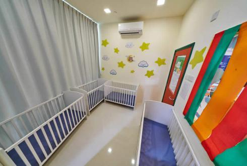 The infant napping room is furnished with full-length day curtains and noise reducing material door to create a conducive sleeping environment. The area is air-conditioned and air purified daily.